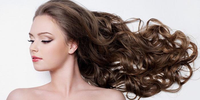 Волосы девушки после применения облепихового масла