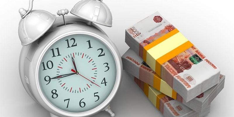 Будильник и пачки денег