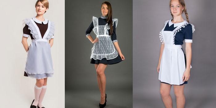 Три модели в школьных платьях с фартуком