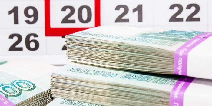 Календарь и денежные купюры