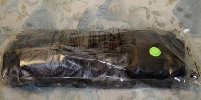 Вещь в вакуумном пакете с клапаном Vaki Paki