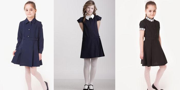 Девочки в разных моделях школьных платьев