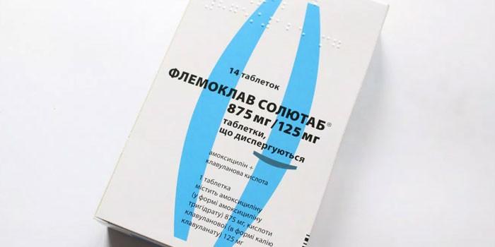 Таблетки Флемоклав в упаковке