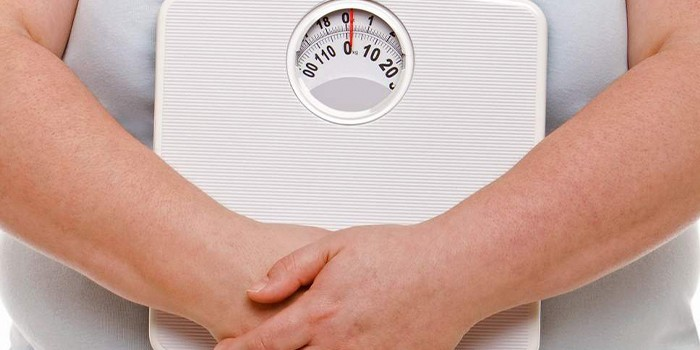 Женщина с весами
